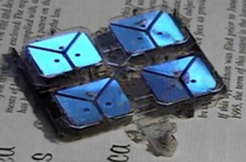 Quad F-Unit Self-Replicator