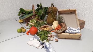 Une composition de nos légumes du marché avec cagette