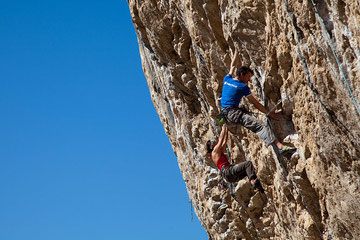 Me, pushing Jack (the north face face) Geldard up a 7c+. Photo by Neil Mawson.