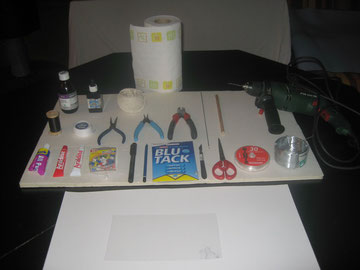 Paraffin oil, blue ink, string, Kitchen roll, bike spoke, dowel, drill, needle and thread, cotton tape, pliers, Bostick, Araldite, push pins, marker, pencil, Blu Tak, scalpel, scissors, fishing line, wire, Bristol board, transparent plastic, (paper) .