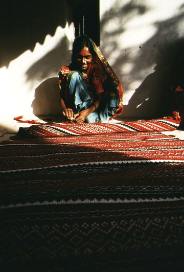 Putting the final touches on a rug; Bhuj, Gujarat, India.
