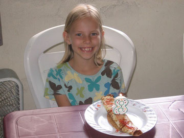 Emily turns 8 on Dec 3rd.  But since we're traveling, we celebrated early. We had crepes with cream cheese filling.