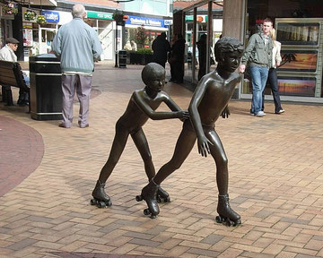 Rollerskaters by John Robinson 1982 in Gracechurch shopping centre. (The statue is now at Hollyfield Primary School.)