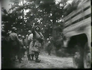 31 October 1944. Higgins is waving goodbye to his men as they head to the rear area near Lepanges, for two days rest and replacement training (courtesy Higgins Family Collection)