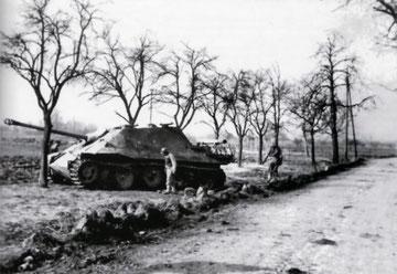 Allied soldiers examine the burnt-out Jagdpanther No 131 of Unteroffizier Karl-Heinz Danisch outside Wickerschweier