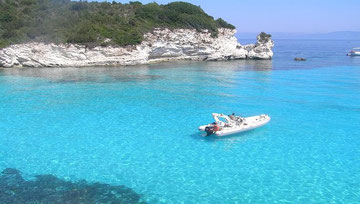 A natural bay in Paxos with emeral green sea