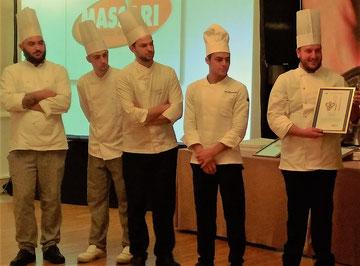Lo Chef  Andrea Nacci (a dx) ed il suo staff