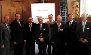 Projektpartner mit Staatssekretär Kapferer (neben Werner Berning)