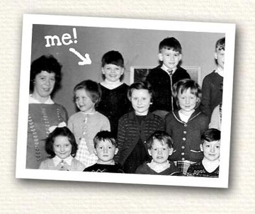 "Black and White primary school class photo with Steve picked out with handwritten text ""Me!"""