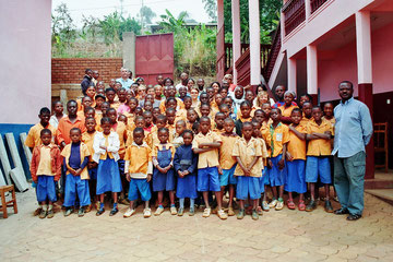 Group photo with the children, Innocent Djonthe and staff