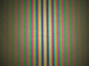 Figure 6. Fringe pattern produced with a Michelson interferometer using white light. As configured here, the central fringe is white rather than black.