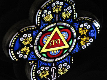 The Tetragrammaton YHWH of the Name of God in the east window of St Martin's Church, West Stockwell Street, Colchester.