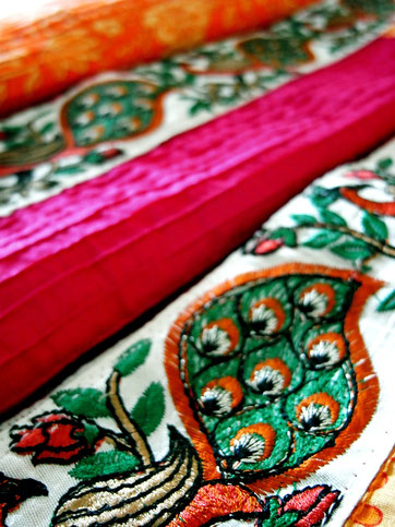 Pink & orange, floral block print, pinched pleat, Indian cotton throw; close-up green & rust peacock jari border