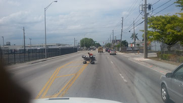 "Picture of young boy riding a ""quad"" on two wheels on the highway... scary stuff"