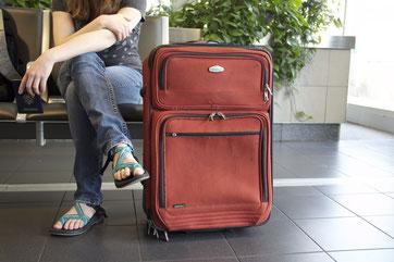Person mit Koffer