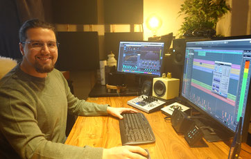 picture of me in my a cappella studio in front of my DAW and Monitor speakers