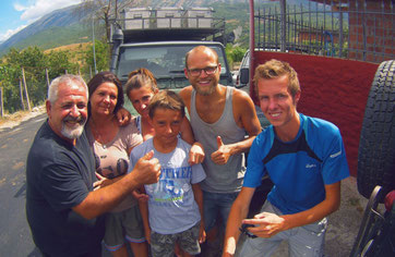 Meeting locals in Albania, they rescued us when the Land Rover broke down.