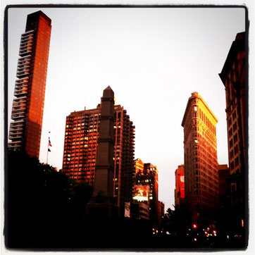 Flatiron building and surrounding buildings at sunset