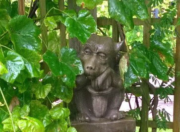 Glum gargoyle in the rain (but maybe he just looks glum because he doesn't have a book?)