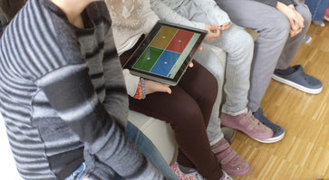 group of students with a tablet