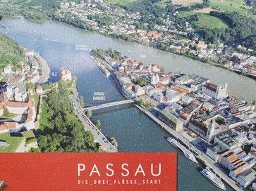 Hinweisschild am Zusammenfluss von Donau und Inn