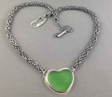 Emerald green sea glass on a custom Byzantine chain. Don't forget the key to your heart with this bespoke clasp featuring an ancient skeleton key from a Zurich flea market.