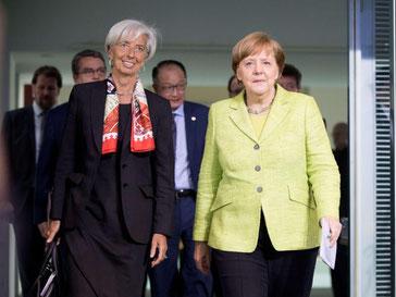 Angela Merkel (r) und die Chefin des Internationalen Währungsfonds, Christine Lagarde. Foto: Kay Nietfeld
