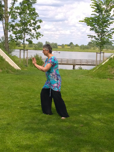 Ellen Hanes practicing Tai Chi and Chi Kung in a garden