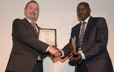 Dirk Schusdziara (left), Fraport Head of Cargo, receives the accolade from Peter Musola, Acting General Manager Cargo, Kenya Airways.