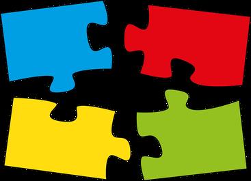 Puzzle-Teile in blau, rot, gelb und grün