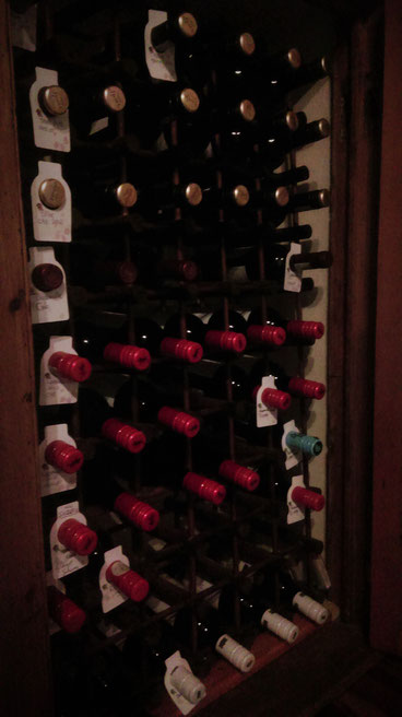 Close-up of the red wine storage, refilled. Bottles of wine, old. South Africa.