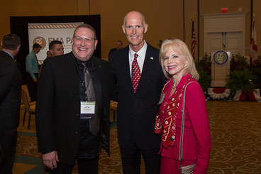 Drs. Aaron Elkins and Dana Wallace with Governor Scott