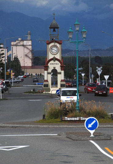 The Hokitika clock tower and the Westland Dairy plant in the background