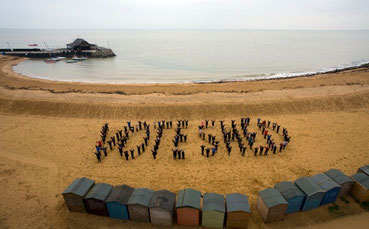 "The pupils of Upton School spell out ""Vote Shed""!"
