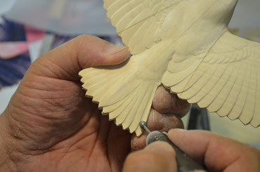 Carving the feathers with a grinder