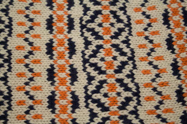 Strickloop Norwegermuster orange-blau