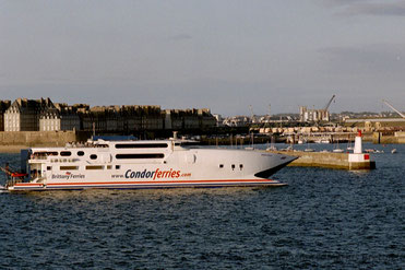 Condor Vitesse entering Saint-Malo's harbour, pictured with the Brittany Ferries' logo on her stern.
