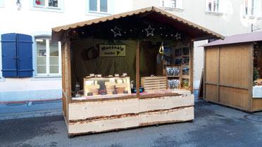 Stand mit Alpkäse am Weihnachtsmarkt