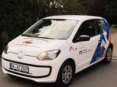 Fahrzeugbeschriftung des Ameisenmobils: Entworfen und gesetzt von Astrid Röben Printmedien in Neuenkirchen.