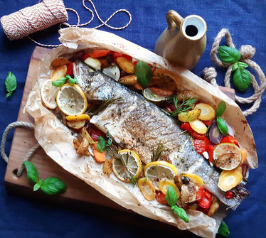 Oven baked Sea bass with potatoes, vegetables and herbs like rosemary, dill, sage, basil !