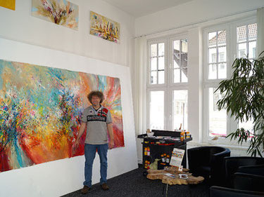 The artist Peter Nottrott with one his large format pieces in his new studio