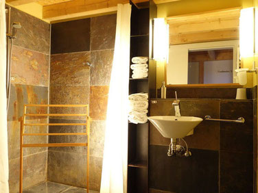 barrierefree showerroom with brasilian slates  in a stacked apartment of the hotel Hafenspeicher in Stralsund