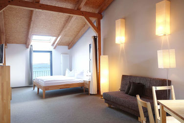 sleeping with view to the sound  in a the attic suite Brückenblick of the hotel Hafenspeicher in Stralsund