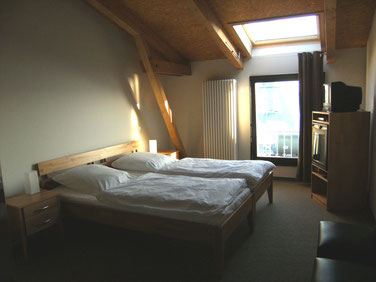 sleeping with view to the sound in the double room of the hotel Hafenspeicher in Stralsund