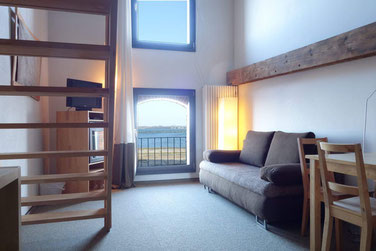 sleeping with view to the sound  in a stacked apartment of the hotel Hafenspeicher in Stralsund