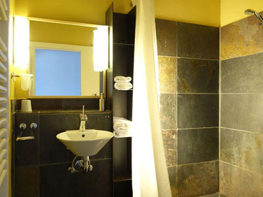 barrierefree shower room in the the duplex suite Rügenbrücked of the hotel Hafenspeicher in Stralsund