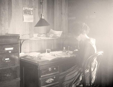 Woman Writing at Old Desk. Harris & Ewing, 1919