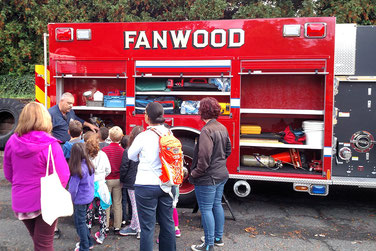 Chief Piccola showing Brunner 2nd Grade students the storage cabinets on Fanwood Engine 7