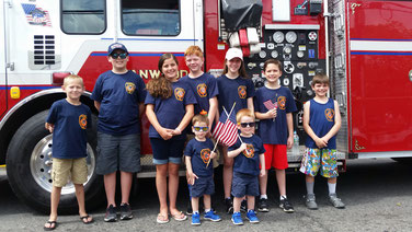 FFD kids pose prior to marching in the parade. Back row left to right: Doug Germinder, Jackson Dietl, Ella Mauer, William Mauer, Emma Route, Aidan Route and Ryan Mauer.  Front Row: James (left) and Justin Marchica