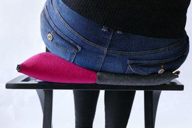 Flowmo Pad in pink mit aufgeblasener Lunftkammer auf der linken Seite